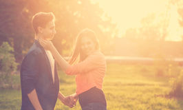Dating couples in park at sunset Royalty Free Stock Image