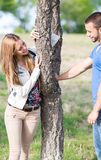 Dating couples. Sharing glances and hugs Royalty Free Stock Photography
