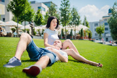 Dating - happy young couple Stock Photos