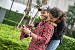 Dating of interracial couple Stock Photos