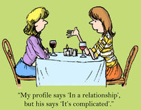 Dating. My profile says 'In a relationship' but his says 'It's complicated Royalty Free Stock Photography