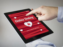 Dating online on a tablet Stock Photo