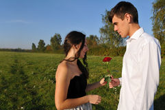 Dating outdoor. With rose. Boy and girl twenty years. You can find more from this series stock image