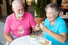 Dating Seniors Enjoy Appetizer Stock Photos