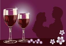 Dating with vine. Dating with wine on table with flowers in the background Stock Image