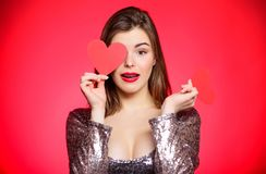 Dating when you have adult braces. Girl pretty wearing orthodontic braces and smiling. How to kiss with braces. Woman. Makeup red lips hold heart symbol love stock photo