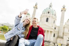 Dating young couple happy in love taking selfie self-portrait ph. Oto in Vienna, Austria Stock Photo