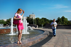 Dating of young men and women. Dating young men and women lovers in city park Stock Photos
