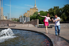 Dating young men and women lovers. In city park Stock Photography