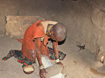 Datoga Woman Grinding Corn Stock Photography