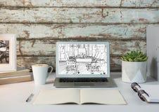 Dator på det vita skrivbordet med ritningen av det nya kontoret (vit och svart) Royaltyfri Fotografi