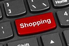 Datoranteckningsboktangentbord med shoppingtangent Arkivfoto