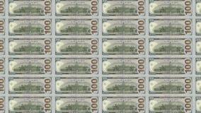 Datoren frambragte videoen med övergångar av amerikan- och Nordkorea sedlar av 100 segrade dollar och 1000 stock video