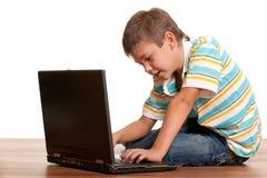 datoriserat barn Fotografering för Bildbyråer