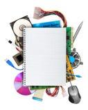 Datormaskinvara med den blanka anteckningsboken Arkivbild