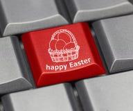Datortangent - lycklig påsk med korgen royaltyfria bilder