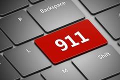 Datortangentbord med nöd- nummer 911 Arkivbild