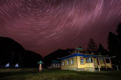 Datsan and mountain with star in night time Royalty Free Stock Photography