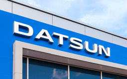 Datsun dealership sign against blue sky Royalty Free Stock Images