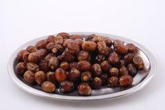 Dattel-Früchte in einer Platte Stockfotos