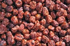 Dattes chinoises rouge foncé de peau Image stock
