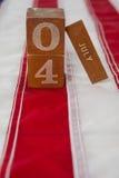 Datumkvarter på amerikanska flaggan med 4th det juli temat Royaltyfri Foto