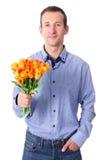 Datummärkningbegrepp - ung man med blommor som isoleras på vit Arkivbilder
