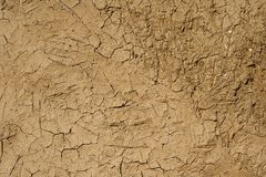 Daub made of mud and cow dung. Close view of a wall plastered with a daub made of mud and cow dung Stock Photo