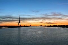 Daugava river and in background TV tower with Riga silhouette, Latvia Royalty Free Stock Photo