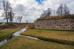 Daugavpils forteca i mała rzeka wokoło go Obrazy Stock