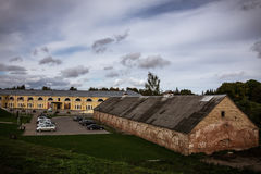 Daugavpils fortress, scene with nice clouds. Daugavpils fortress. Mark Rothko Art Center. Famous place in Latvia. Nice scene with no people, cars parked Stock Photography