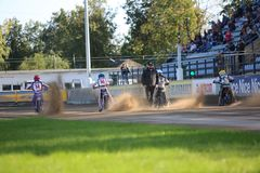 Speedway riders on the track. DAUGAVPILS, LATVIA -September 24, 2017: Speedway riders on the track. Open individual Latvian championship 2017 stock images