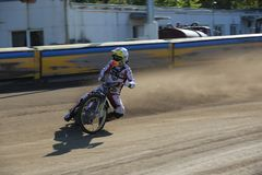 Speedway riders on the track. DAUGAVPILS, LATVIA -September 24, 2017: Speedway riders on the track. Open individual Latvian championship 2017 royalty free stock photo