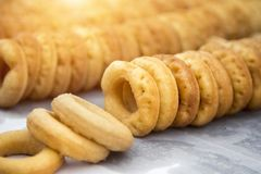 Daugh roll of donut dessert on paper after boil from hot oil. Close up dough roll of donut dessert on paper after boil from hot oil stock photo