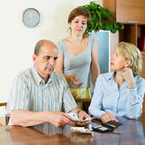 Daughter asking parents for money Royalty Free Stock Photo