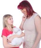 Daughter asks her mum for a cat Stock Photos