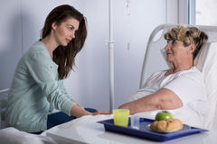 Daughter assisting ill mother Stock Image