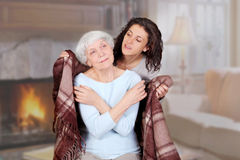 Daughter carefully conceals mom blanket Royalty Free Stock Photos