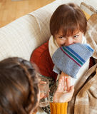 Daughter caring for sick mature mother has cough Stock Photography
