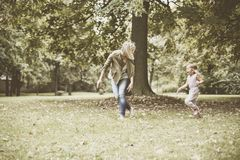 Mother playing with her daughter. royalty free stock photo