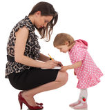 Daughter is checking mom's organizer Royalty Free Stock Photos
