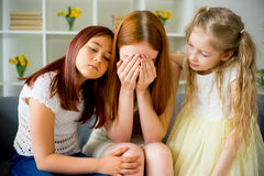 Daughter comforting their mother Royalty Free Stock Image