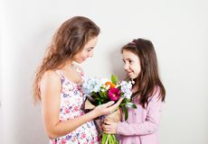 Togetherness mom and daughter stock photos