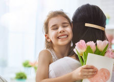 Daughter congratulates mom Royalty Free Stock Image