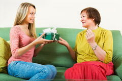 Daughter congratulating happy mature mother Stock Image