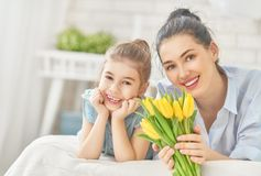 Daughter congratulating mom Royalty Free Stock Photography