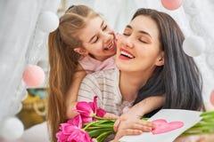 Daughter is congratulating mom Stock Photos