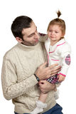 Daughter crying at the daddy on his hands Royalty Free Stock Photos
