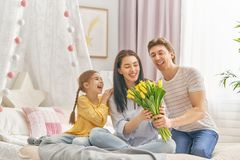 Daughter with dad congratulating mom Royalty Free Stock Photo