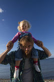 Daughter and dad relax on the beach. Royalty Free Stock Photography